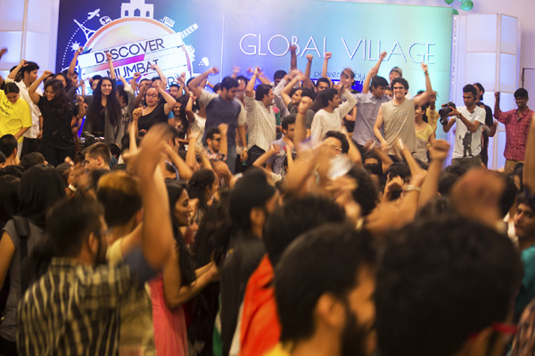 Reveling attendees of the global village